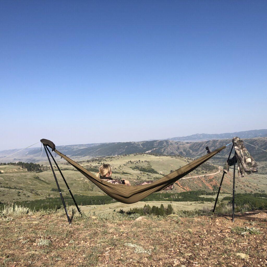 girl in hammock stand with binoculars